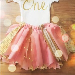 One 12 month old onesie and tutu